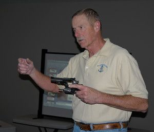 Dan teaching basic pistol